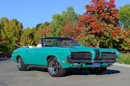 AUT 23 RK3508 01 © Kimball Stock 1970 Mercury Cougar Grabber Green 3/4 Front View On Pavement By Trees