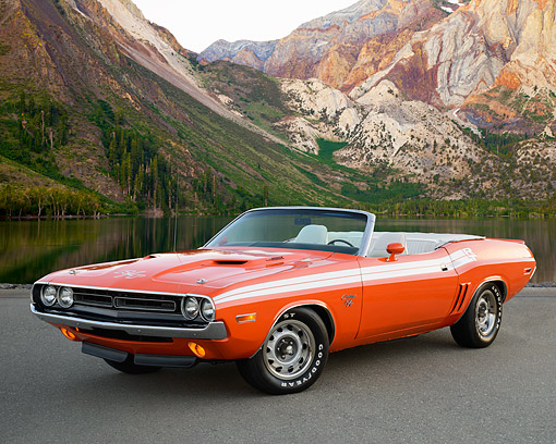 AUT 23 RK3513 01 © Kimball Stock 1971 Dodge Challenger R/T Convertible Hemi Orange 3/4 Front View On Pavement By Lake And Mountains