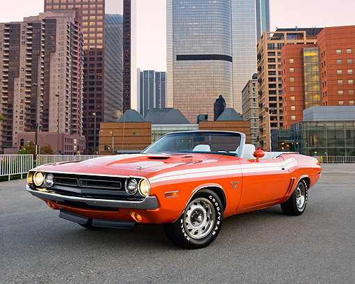 AUT 23 RK3514 01 © Kimball Stock 1971 Dodge Challenger R/T Convertible Hemi Orange 3/4 Front View On Pavement By Buildings