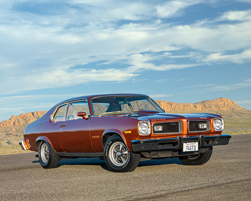 AUT 23 RK3518 01 © Kimball Stock 1974 Pontiac GTO Metallic Bronze 3/4 Front View On Pavement In Desert