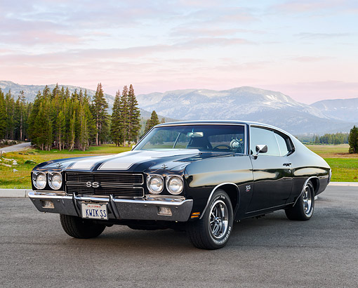 AUT 23 RK3524 01 © Kimball Stock 1970 Chevrolet Chevelle SS 454 Black With White Stripes 3/4 Front View On Pavement By Field And Mountains