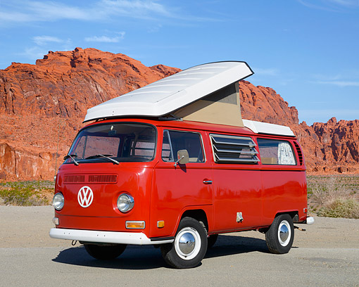 AUT 23 RK3528 01 © Kimball Stock 1970 Volkswagon Campmobile Montana Red 3/4 Front View On Pavement