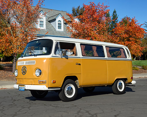AUT 23 RK3536 01 © Kimball Stock 1971 Volkswagon Bus Sierra Gold 3/4 Front View On Pavement By House