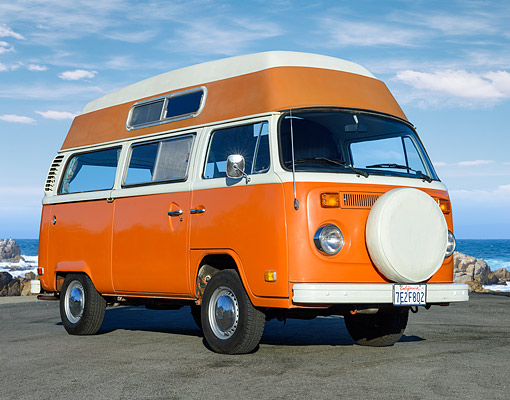 AUT 23 RK3537 01 © Kimball Stock 1974 Volkswagon Wanderlust Bus Orange 3/4 Front View On Pavement