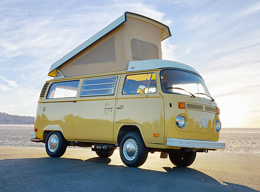 AUT 23 RK3543 01 © Kimball Stock 1976 Volkswagon Westfalia Yellow 3/4 Front View On Pavement