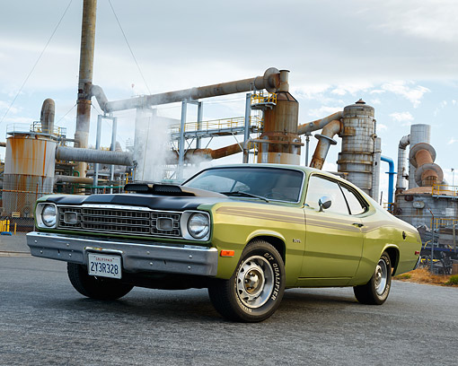 AUT 23 RK3558 01 © Kimball Stock 1973 Plymouth Duster 340 Green With Black Stripes 3/4 Front View On Pavement By Factory