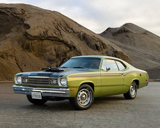 AUT 23 RK3559 01 © Kimball Stock 1973 Plymouth Duster 340 Green With Black Stripes 3/4 Front View On Pavement