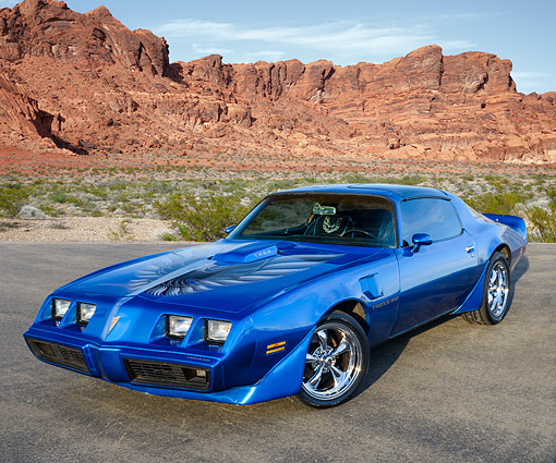 AUT 23 RK3560 01 © Kimball Stock 1979 Pontiac Trans Am 6.6 Liter Blue 3/4 Front View On Pavement In Desert