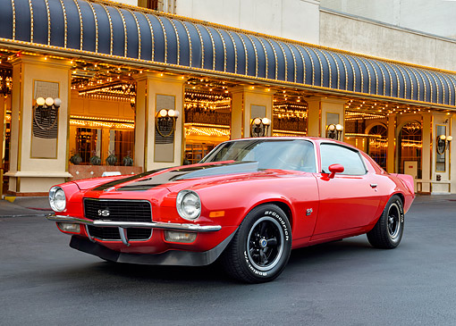 AUT 23 RK3567 01 © Kimball Stock 1970 Chevrolet Camaro SS Red With Black Stripes 3/4 Front View In Front Of Fancy Hotel