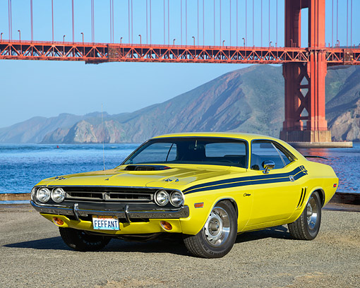 AUT 23 RK3692 01 © Kimball Stock 1971 Dodge Challenger 426 Hemi Yellow With Black Stripe 3/4 Front View On Pavement By Bridge