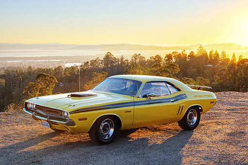 AUT 23 RK3694 01 © Kimball Stock 1971 Dodge Challenger 426 Hemi Yellow With Black Stripe 3/4 Front View On Pavement By Trees And Water