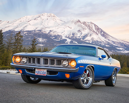 AUT 23 RK3696 01 © Kimball Stock 1971 Plymouth Barracuda Blue Low 3/4 Front View On Pavement By Snowy Mountain