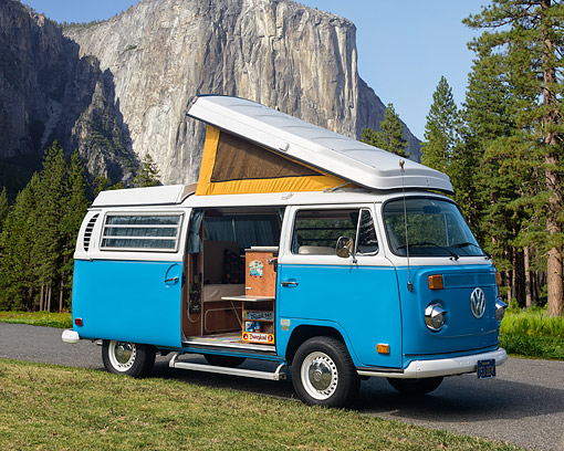 AUT 23 RK3701 01 © Kimball Stock 1971 Volkswagen Camper Bus Blue 3/4 Front View By Forest Mountains