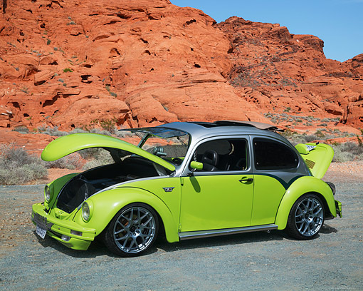 AUT 23 RK3705 01 © Kimball Stock 1972 Volkswagen Beetle Custom Green And Silver 3/4 Front View By Desert Rocks