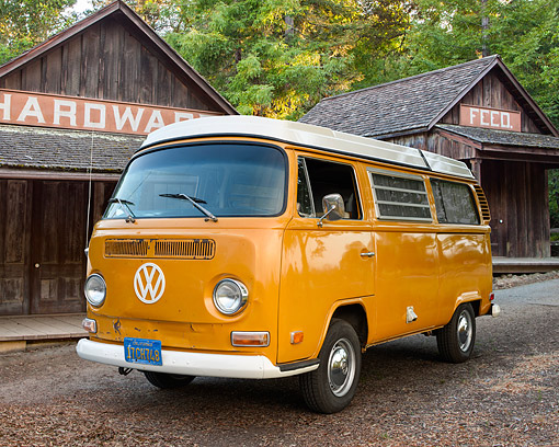 AUT 23 RK3709 01 © Kimball Stock 1972 Volkswagen Westfalia Camper Bus Orange 3/4 Front View By Hardware Store