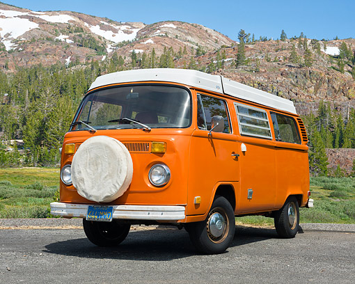 AUT 23 RK3712 01 © Kimball Stock 1975 Volkswagen Westfalia Camper Bus Orange 3/4 Front View By Forest Mountain