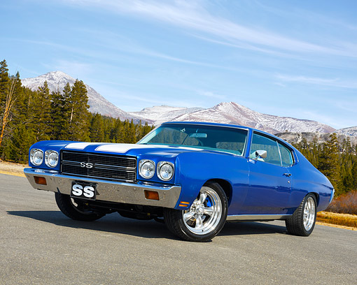 AUT 23 RK3718 01 © Kimball Stock 1970 Chevrolet Chevelle SS Blue With White Stripes 3/4 Front View On Pavement By Forest And Mountains