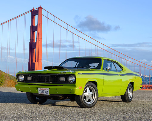 AUT 23 RK3724 01 © Kimball Stock 1971 Plymouth Duster 225 Green 3/4 Front View On Pavement By Golden Gate Bridge