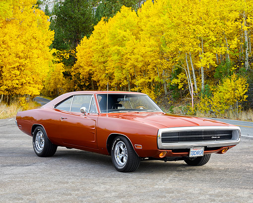 AUT 23 RK3728 01 © Kimball Stock 1970 Dodge Charger Dark Burnt Orange 3/4 Front View On Road By Autumn Trees
