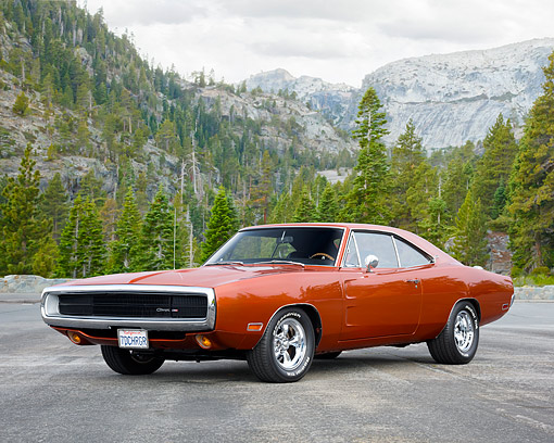 AUT 23 RK3729 01 © Kimball Stock 1970 Dodge Charger Dark Burnt Orange 3/4 Front View On Road By Forest Mountain