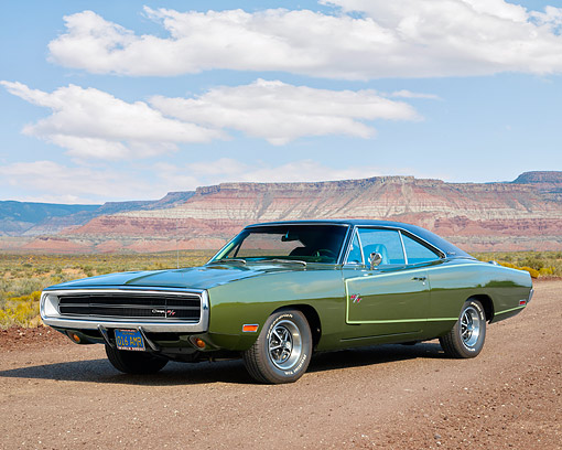 AUT 23 RK3730 01 © Kimball Stock 1970 Dodge Charger R/T Green 3/4 Front View On Dirt Road In Desert