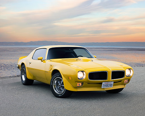 AUT 23 RK3735 01 © Kimball Stock 1971 Pontiac Firebird Trans Am Yellow Low 3/4 Front View On Pavement