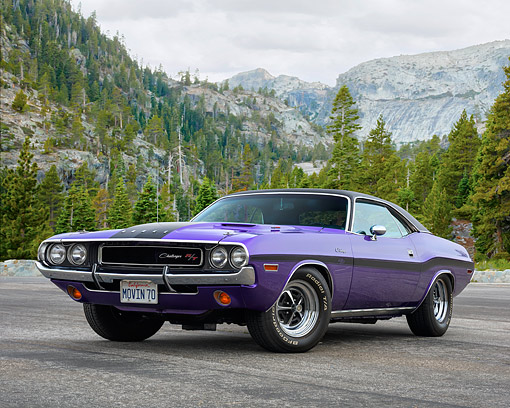 AUT 23 RK3737 01 © Kimball Stock 1970 Dodge Challenger R/T Plum Crazy Purple 3/4 Front View By Forest Mountain Trees
