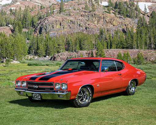 AUT 23 RK3744 01 © Kimball Stock 1970 Chevrolet Chevelle SS 454 LS6 Cowl Induction Red With Black Stripes 3/4 Front View On Grass By Trees And Mountain
