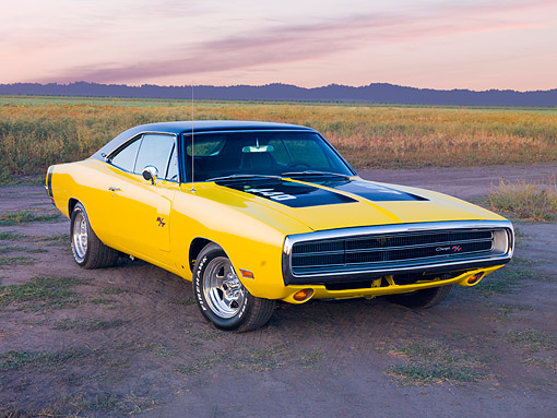 AUT 23 RK3752 01 © Kimball Stock 1970 Dodge Charger R/T 440 Yellow 3/4 Front View On Dirt Road By Field And Mountains