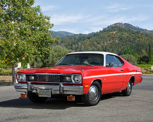 AUT 23 RK3756 01 © Kimball Stock 1975 Plymouth Duster Red 3/4 Front View On Pavement By Trees