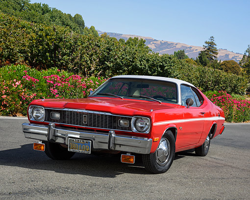 AUT 23 RK3757 01 © Kimball Stock 1975 Plymouth Duster Red 3/4 Front View On Pavement By Trees