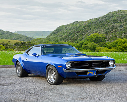 AUT 23 RK3770 01 © Kimball Stock 1970 Plymouth Barracuda Blue 3/4 Front View By Grass And Mountains