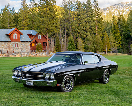 AUT 23 RK3776 01 © Kimball Stock 1970 Chevrolet Chevelle SS 454 Cowl Induction Black 3/4 Front View By Cabin And Trees