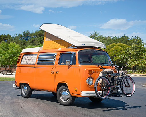 AUT 23 RK3783 01 © Kimball Stock 1973 Volkswagen Bus Westfalia Camper Orange 3/4 Front View On Pavement By Park