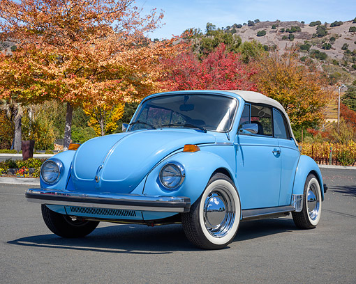 AUT 23 RK3784 01 © Kimball Stock 1979 Volkswagen Super Beetle Convertible Light Blue 3/4 Front View By Trees