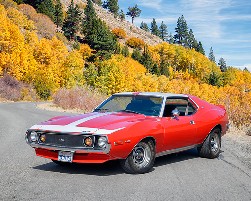 AUT 23 RK3789 01 © Kimball Stock 1972 American Motors AMX Javelin 401 Red 3/4 Front View By Autumn Trees