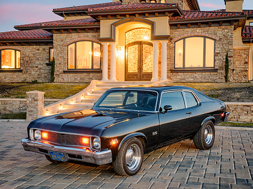 AUT 23 RK3803 01 © Kimball Stock 1973 Chevrolet Nova SS 350 Green 3/4 Front View On Cobblstone By Mansion At Sunset
