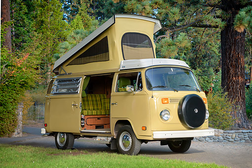 AUT 23 RK3805 01 © Kimball Stock 1977 Volkswagen Bus Yellow 3/4 Front View By Trees