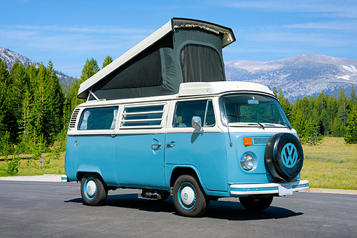AUT 23 RK3806 01 © Kimball Stock 1975 Volkswagen Westafalia Camper Bus Blue 3/4 Front View In Forest Meadow