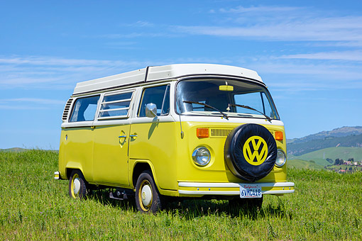 AUT 23 RK3807 01 © Kimball Stock 1975 Volkswagen Westafalia Camper Bus Yellow 3/4 Front View On Grass
