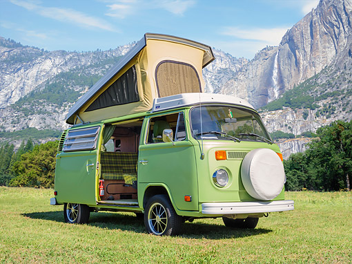 AUT 23 RK3810 01 © Kimball Stock 1974 Volkswagen Camper Bus Green 3/4 Front View By Mountains