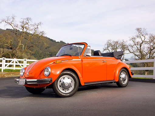 AUT 23 BK0002 01 © Kimball Stock 1974 Volkswagen Cabriolet Orange Peel 3/4 Front View On Pavement By White Fence And Hills