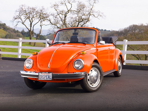 AUT 23 BK0003 01 © Kimball Stock 1974 Volkswagen Cabriolet Orange Peel 3/4 Front View On Pavement By White Fence And Hills