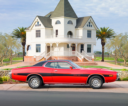 AUT 23 BK0008 01 © Kimball Stock 1973 Dodge Charger SE 440 Red With Black Stripe Profile View On Pavement By House