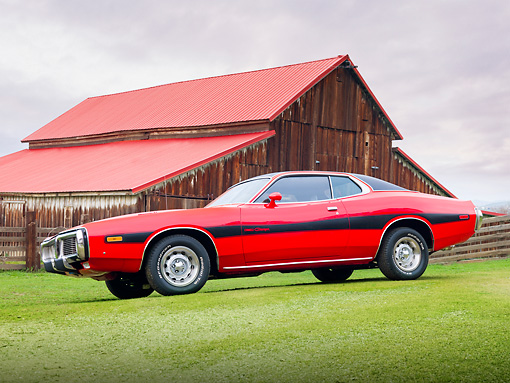 AUT 23 BK0010 01 © Kimball Stock 1973 Dodge Charger SE 440 Red With Black Stripe 3/4 Front View On Grass By Barn