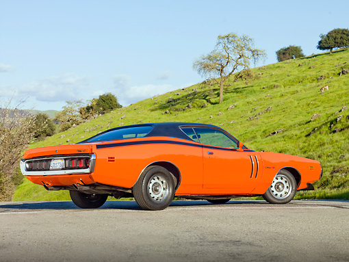AUT 23 BK0020 01 © Kimball Stock 1971 Dodge Charger 440 Magnum R/T Orange 3/4 Rear View On Pavement By Hill