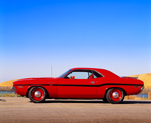 AUT 23 RK0005 01 © Kimball Stock 1970 Dodge Hemi Challenger Red Profile View On Pavement