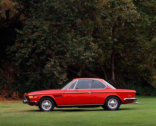 AUT 23 RK0046 01 © Kimball Stock 1972 BMW 3.0 CS Red Profile View On Grass