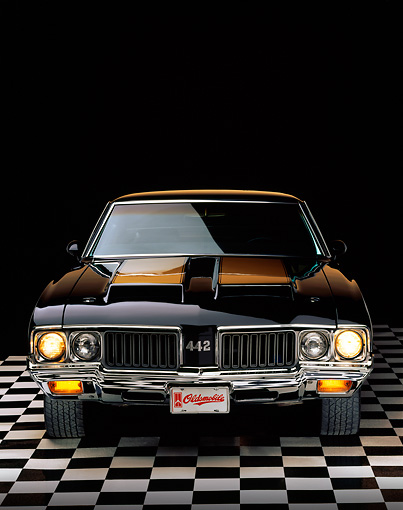 AUT 23 RK0098 03 © Kimball Stock 1970 Oldsmobile 442 W-30 Black And Gold Stripe Head On Shot On Checkered Floor Studio