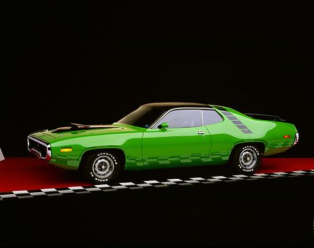 AUT 23 RK0106 01 © Kimball Stock 1971 Plymouth Road Runner 440 6-Pac Green 3/4 Side View On Checkered Line Red Floor Studio